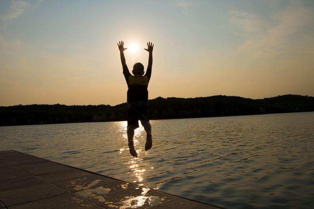 Still Water Resort Boy Jumping