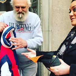 Handing out coats to the homeless