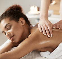 attractive-african-woman-having-massage-relaxing-in-spa-salon-closed-eyes.jpg