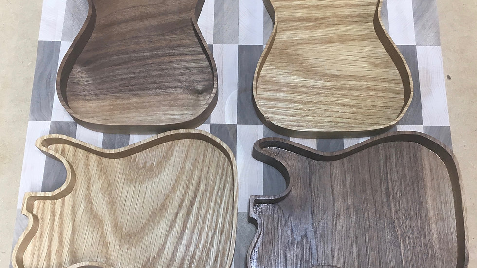 Top left and bottom right: Walnut.  Top right and bottom left: White Oak