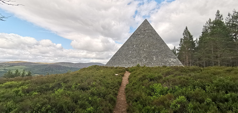 The dramatic and imposing sight of the pyramid megalith that sits high atop a hill surrounded by dense ancient forest