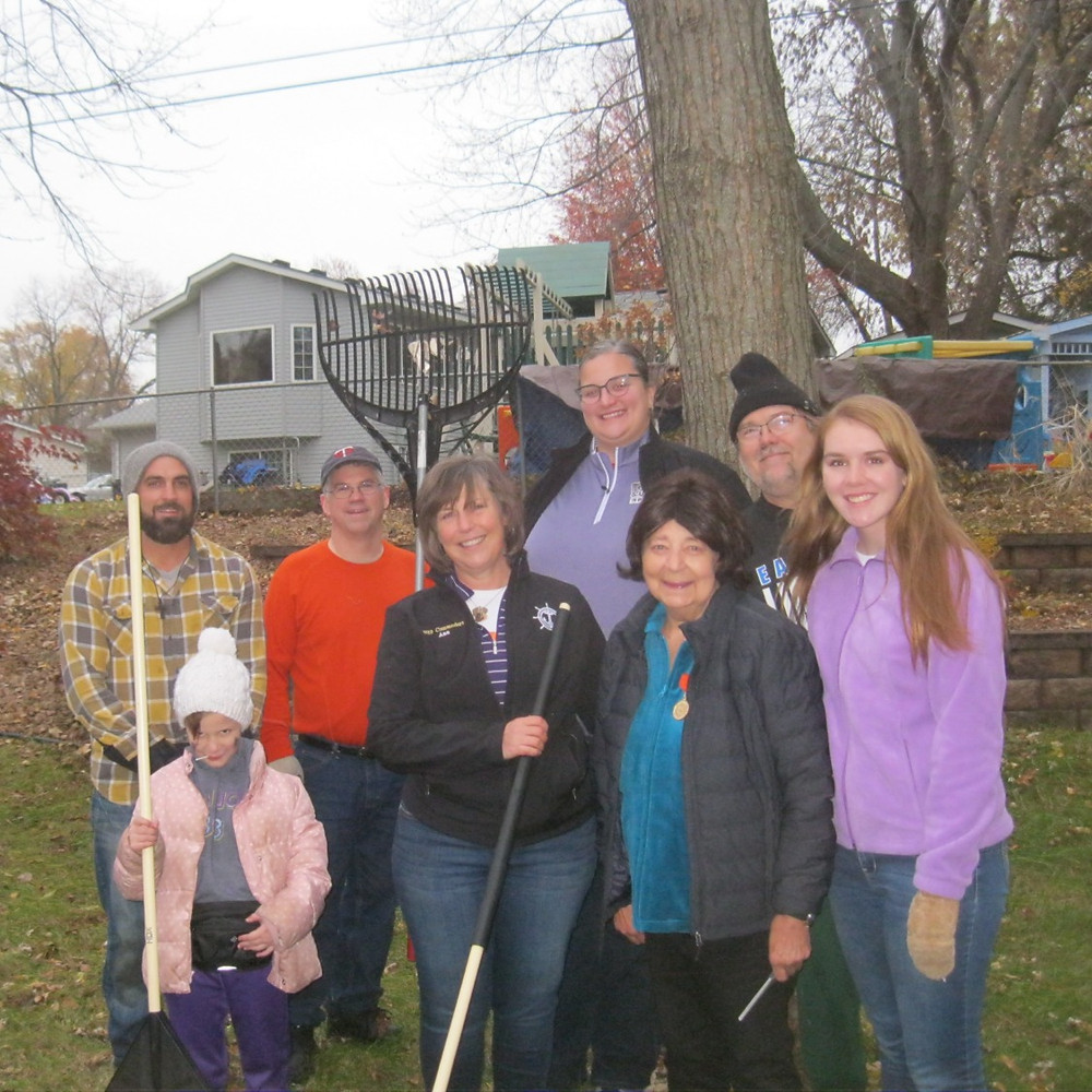 Ambassador team and friends/family clean-up Carol's yard in Eagan