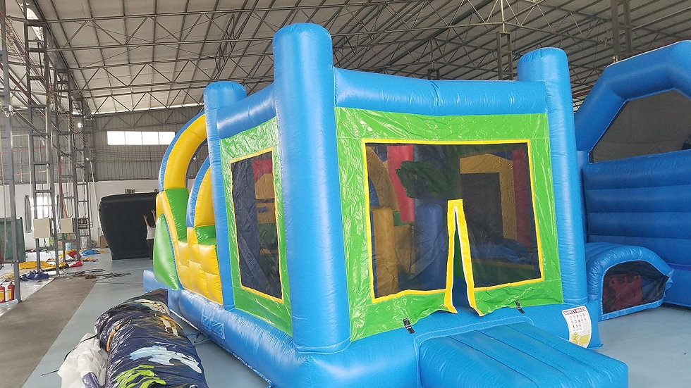 green and yellow jumping castle with obstacle slide