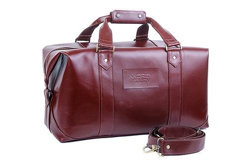 Дорожная сумка с тиснением.