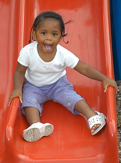 This is a picture of girl on slide.