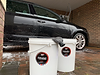 Wash & Rinse buckets in front of a soapy car