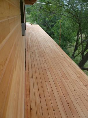 Bardage bois et balcon en bois