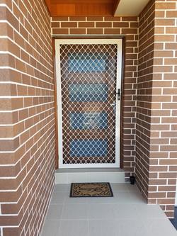 Diamond Grille Barrier Door