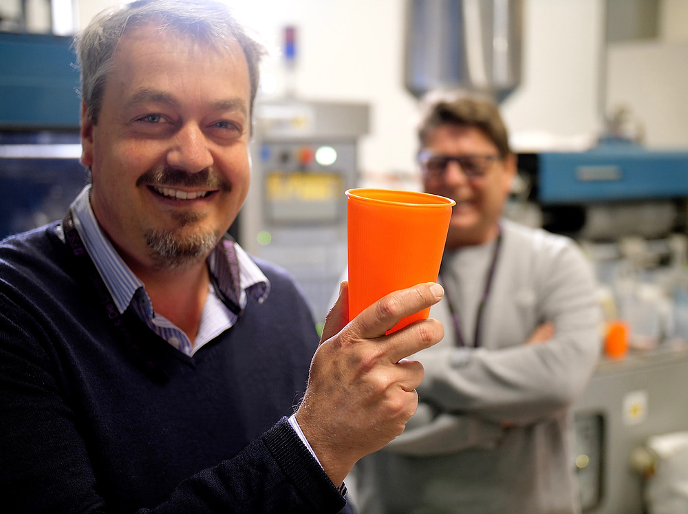Picture of the founders holding a reusable EcoCore cup at the Bockatech research and development facility