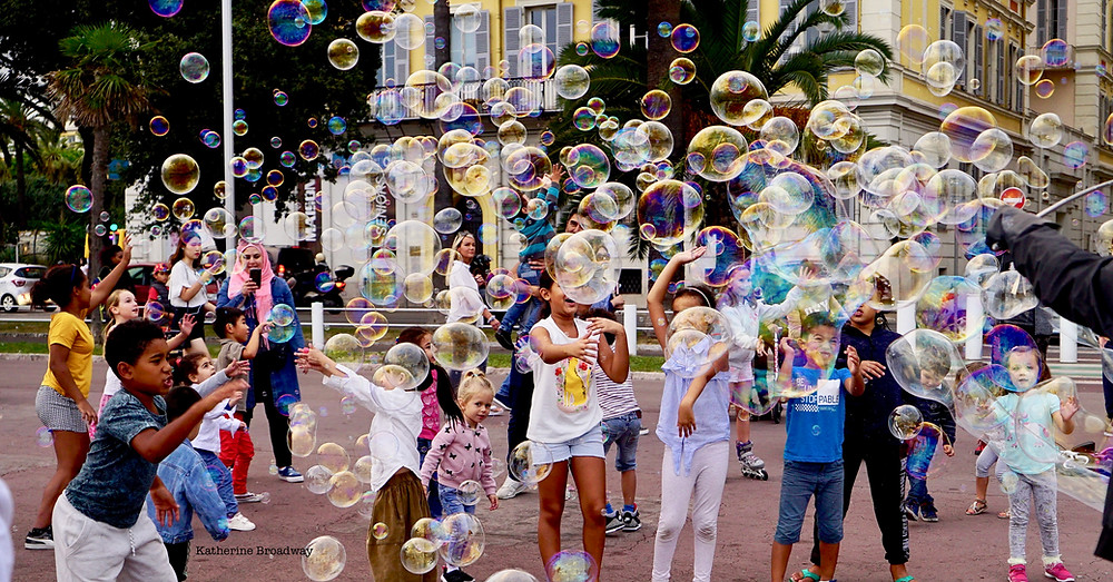 Image of kids on playground blowing bubbles.Raleigh Psychotherapy, counseling, Parts, Katherine Broadway