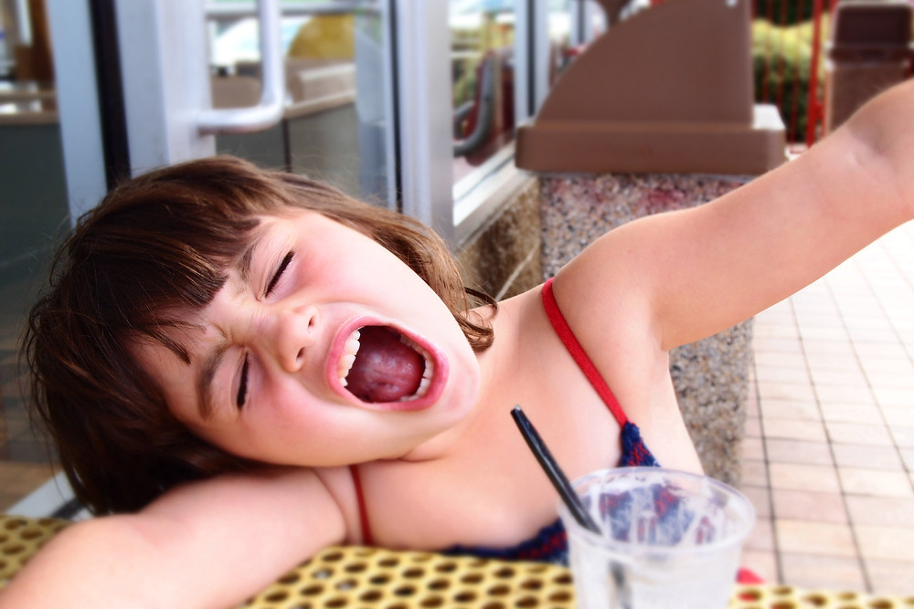 Image of yawning child. Raleigh Psychotherapy, Counseling, Katherine Broadway, Harsh Inner Critic