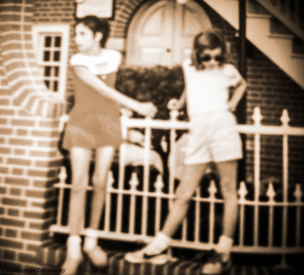 Image of 2 young teen girls posing against a white wrought iron fence. Raleigh Psychotherapy, counseling, True self, Katherine Broadway