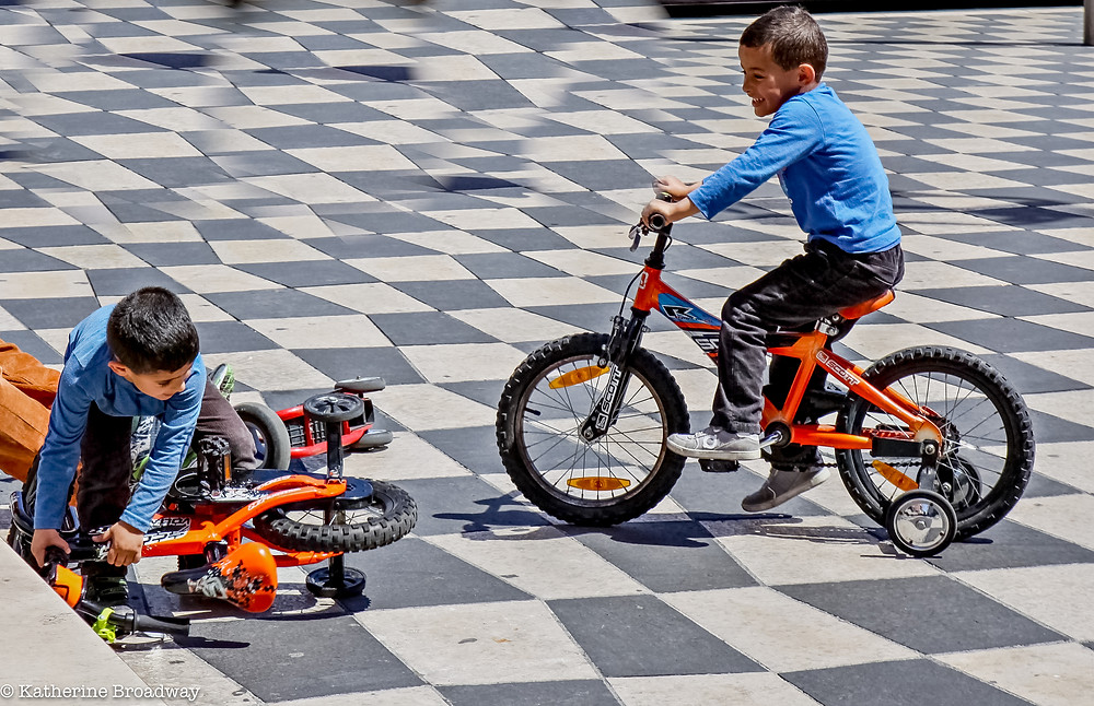 Image of two young boys on orange bikes with training wheels. counseling, Raleigh, therapy, Katherine Broadway