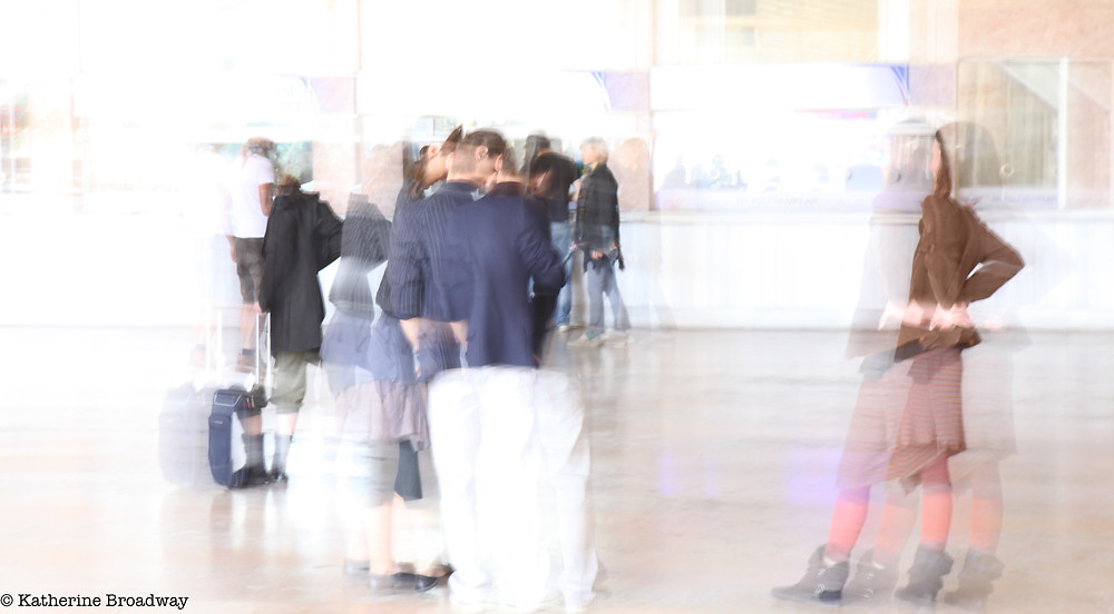Image of people gathering, blurred to connote chaos. Raleigh Psychotherapy, counseling, Chaos, Katherine Broadway