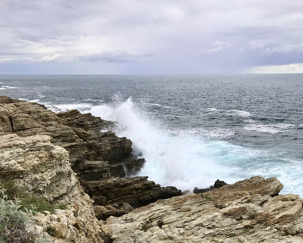 Image of waves crashing on rocks.  Raleigh Psychotherapy, counseling, love, hate, Katherine Broadway