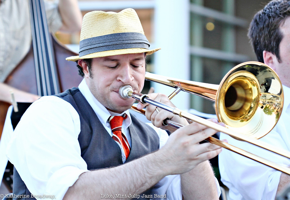 Image of man wearing a hat and vest, playing a trombone.Raleigh Psychotherapy, counseling, Mint Julep Jazz Band, aggression