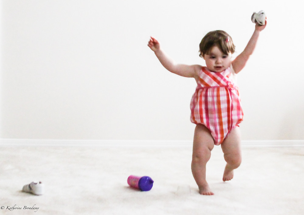 Image of a toddler joyfully trying to walk. Raleigh Psychotherapy, counseling, Katherine Broadway