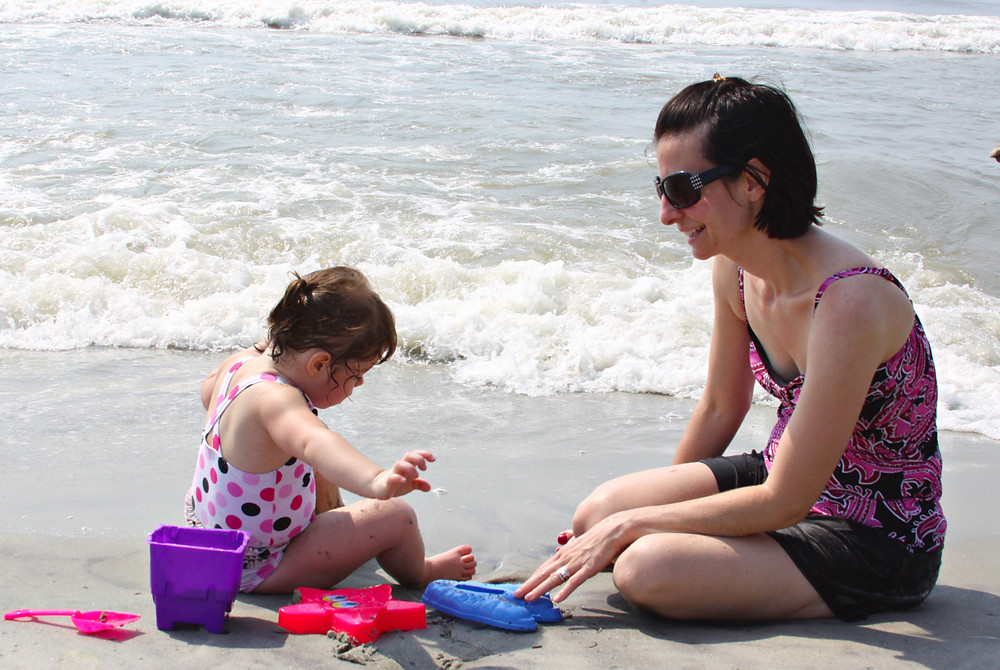 Image of mom and toddler at the beach. Raleigh Psychotherapy, Katherine Broadway, Counseling, self-parenting