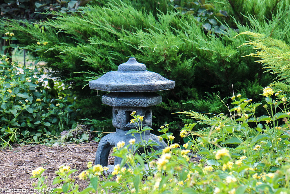 Image of a Japanese stone pagoda in a garden.  Raleigh Psychotherapy, counseling, mindfulness, Katherine Broadway