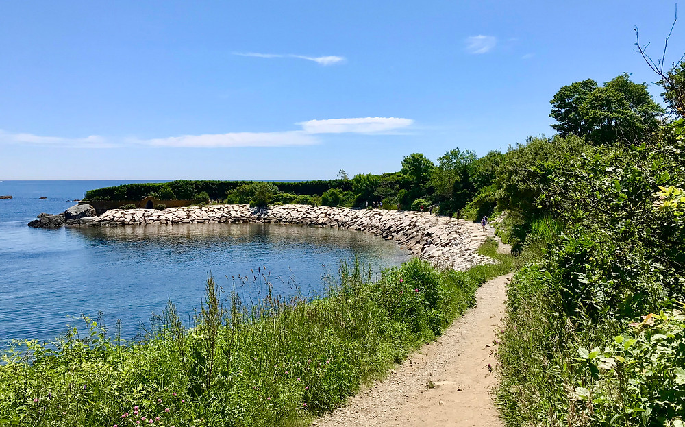 Image of dirt path along water's edge of a calm bay. Raleigh Psychotherapy, counseling, teach others, Katherine Broadway