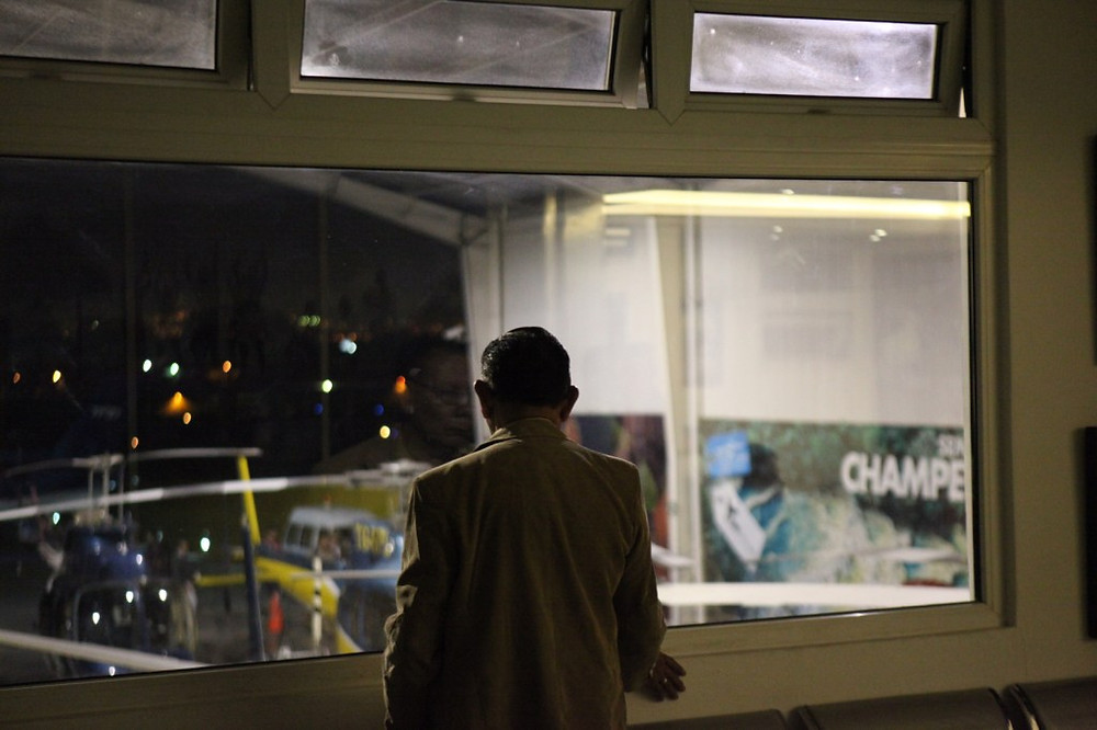 Photo of person looking out a window at night. © Katherine Broadway | Overcome shame at Raleigh Psychotherapy