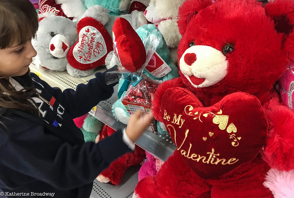 Image of a young girl choosing a stuffed bear. Valentine's Day, Raleigh Psychotherapy, counseling, Katherine Broadway, MDiv, LPC