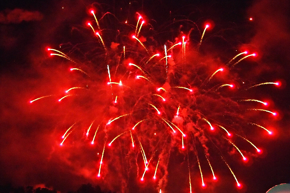 Image of red fireworks. Raleigh Psychotherapy, counseling, New Year, Katherine Broadway