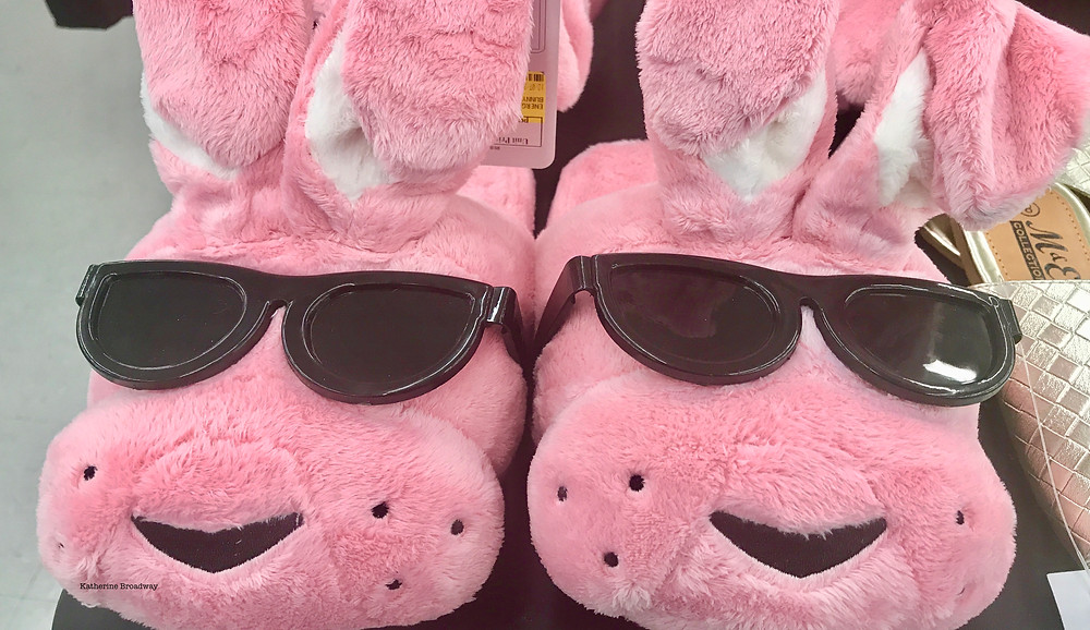 Image of 2 pink bunny slippers with black sunglasses. Raleigh Psychotherapy, counseling, codependency, Katherine Broadway