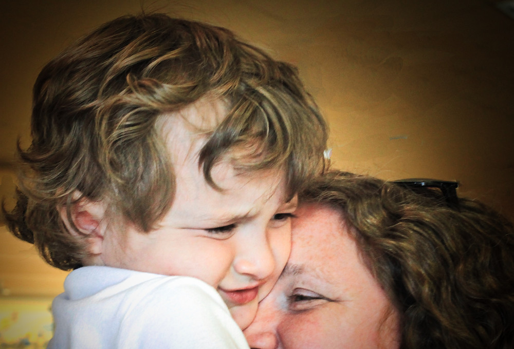 Image of worried child hugging his mom. Raleigh Psychotherapy, counseling, bad news, Katherine Broadway