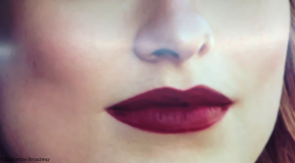Image of female face with focus on dark red lips. Raleigh Psychotherapy, counseling, selfish, Broadway