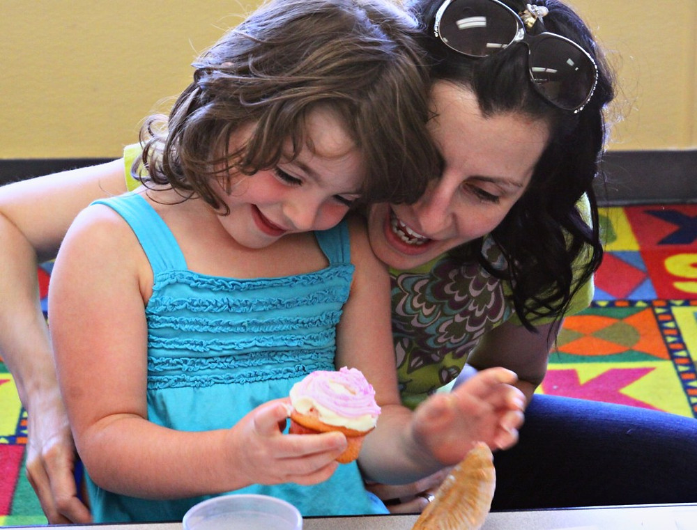 Photo of child and mom with cupcake. © Katherine Broadway, Raleigh Psychotherapy, Orlando shooting