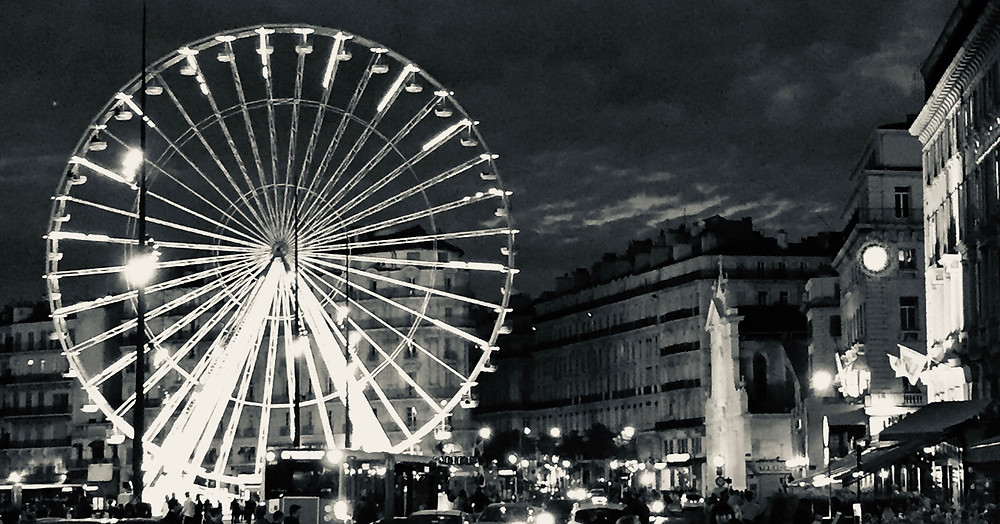 Image of Ferris Wheel in city setting, in black and white. Raleigh Psychotherapy, counseling, Memories, Katherine Broadway