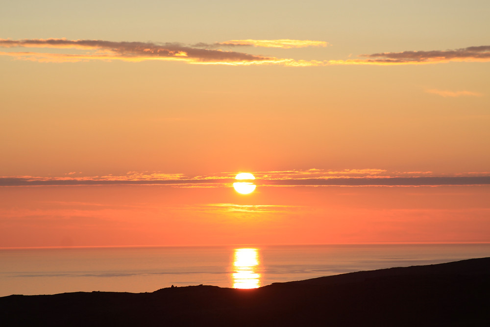 Image of orange sunset on ocean. Raleigh psychotherapy, counseling, Katherine Broadway, hope
