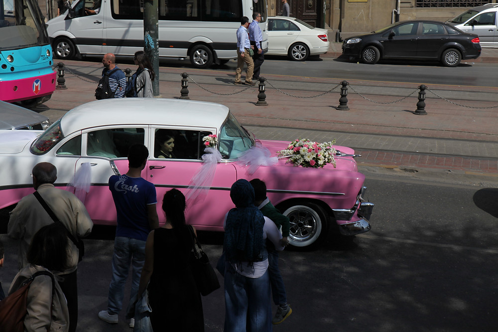 Image of old pink and white car with bridal flowers. Raleigh Psychotherapy, Counseling, Katherine Broadway, relationships