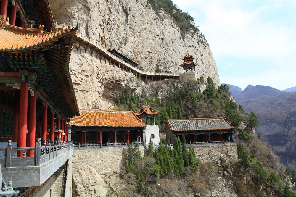 photo of Asian cliffside monastery © Katherine Broadway