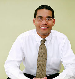 Image of African American businessman smiling about Counseling for ACOA & Dysfunctional Families