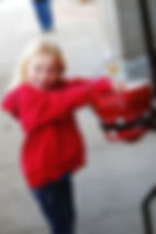 Girl placing money1.jpg