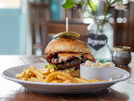 The Station Burger, Smoked Bacon, Cheddar Cheese, Caramelized Onion, Burger Sauce, Slaw & Fries