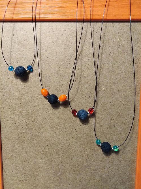 pendentif pierre de lave et perle de verre