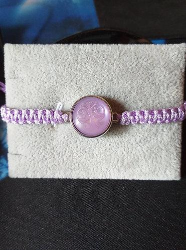 bracelet tissé en coton perlé et pression