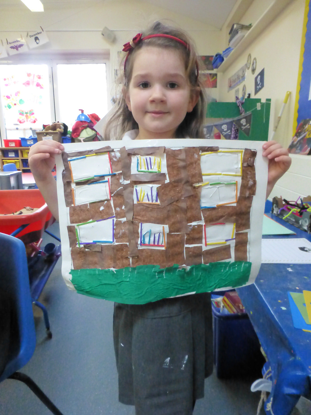 Faith showing her collage