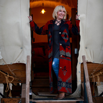 Noreen exits a covered wagon at Frandy P