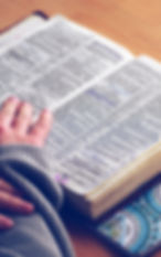 Canva - Person reading Bible at table.jp