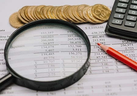 coins-magnifying-glass-pencil-calculator