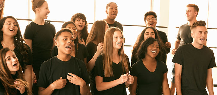 Male And Female Students Singing In Choir At Performing Arts School_edited.jpg