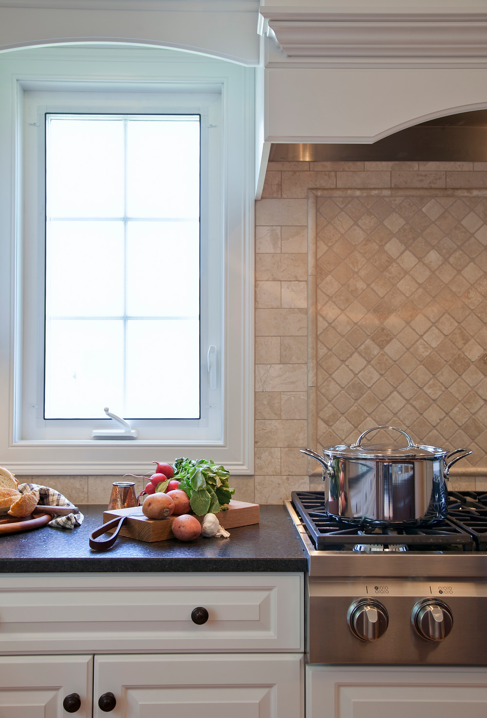 White kitchen with soup cooking on gas cooktop
