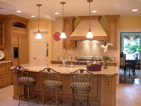Traditional style kitchen with decorative hood
