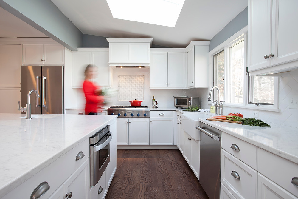Quartz countertops mimic marble in white kitchen