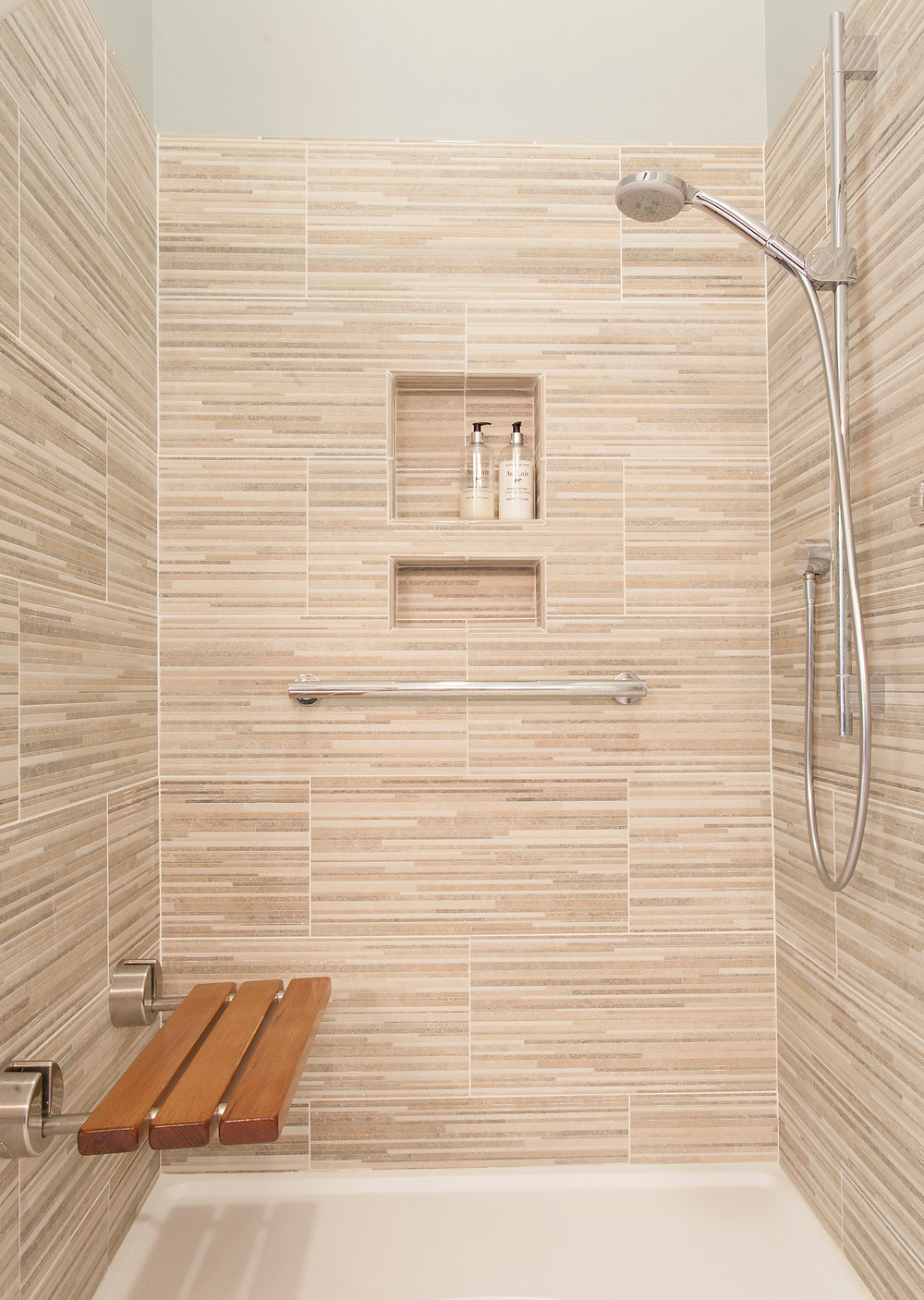 Shower with fold-down shower seat