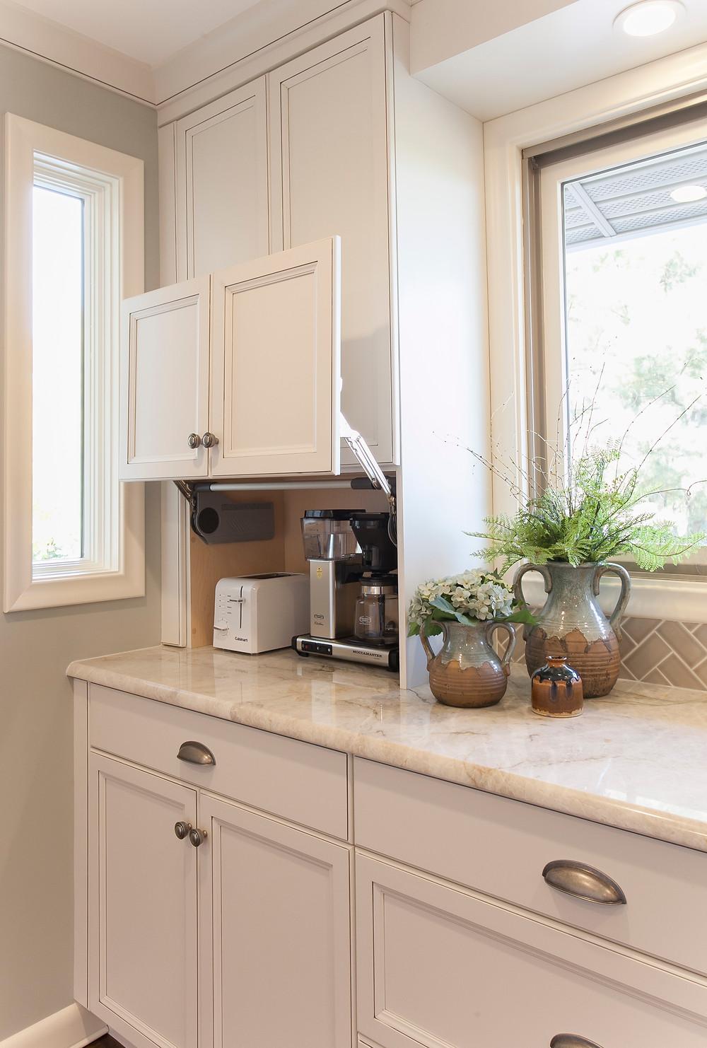 Appliance garage hides small kitchen gadgets.
